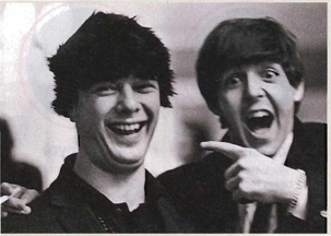 Brian Epstein in a Beatle wig (with Paul)